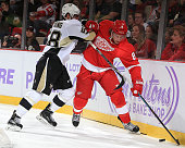 Justin Abdelkader of the Detroit Red Wings skates with the puck as Kris Letang of the Pittsburgh Penguins puts a body on him during a NHL game on...
