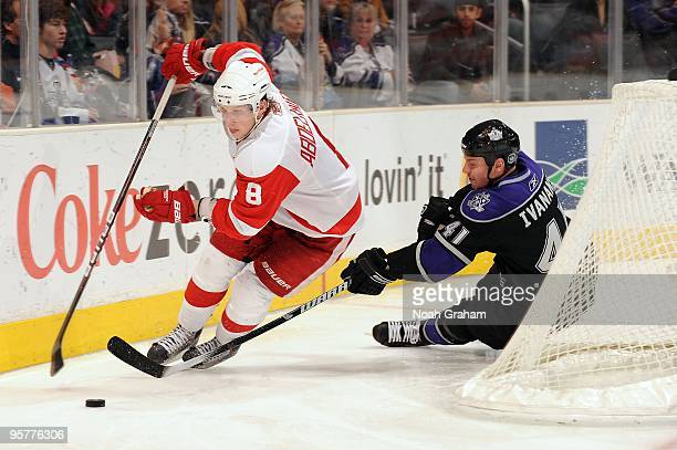 Justin Abdelkader of the Detroit Red Wings skates with the puck against Raitis Ivanans of the Los Angeles Kings on January 7 2010 at Staples Center...