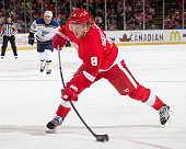 Justin Abdelkader of the Detroit Red Wings takes a slap shot during a NHL game against the St Louis Blues on March 22 2015 at Joe Louis Arena in...