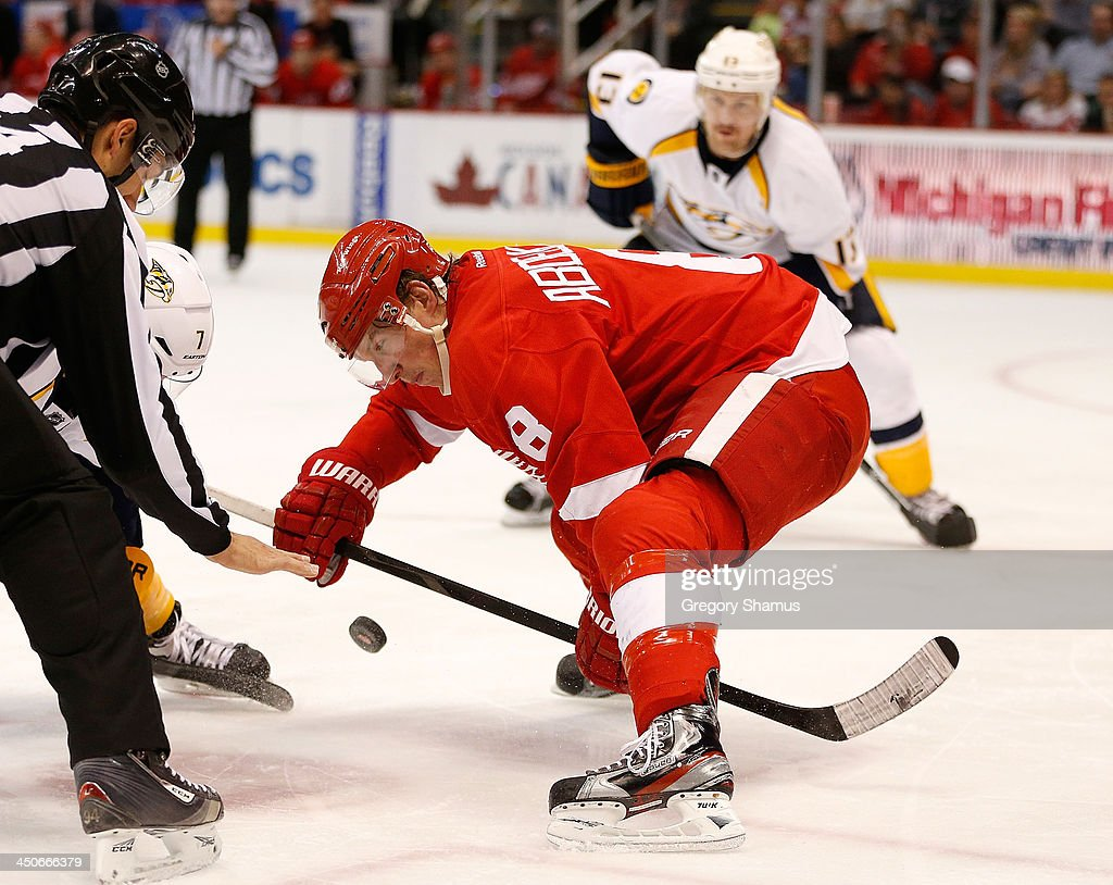 <a gi-track='captionPersonalityLinkClicked' href=/galleries/search?phrase=Justin+Abdelkader&family=editorial&specificpeople=2271858 ng-click='$event.stopPropagation()'>Justin Abdelkader</a> #8 of the Detroit Red Wings takes a third-period faceoff against Matt Cullen #7 of the Nashville Predators at Joe Louis Arena on November 19, 2013 in Detroit, Michigan. Nashville won the game 2-0.