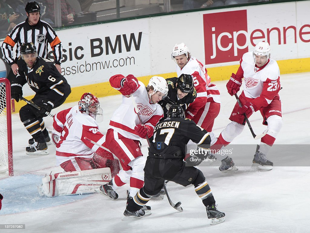 <a gi-track='captionPersonalityLinkClicked' href=/galleries/search?phrase=Justin+Abdelkader&family=editorial&specificpeople=2271858 ng-click='$event.stopPropagation()'>Justin Abdelkader</a> #8 of the Detroit Red Wings tries to keep the puck out of the net against <a gi-track='captionPersonalityLinkClicked' href=/galleries/search?phrase=Toby+Petersen&family=editorial&specificpeople=619034 ng-click='$event.stopPropagation()'>Toby Petersen</a> #17 of the Dallas Stars at the American Airlines Center on January 17, 2012 in Dallas, Texas.