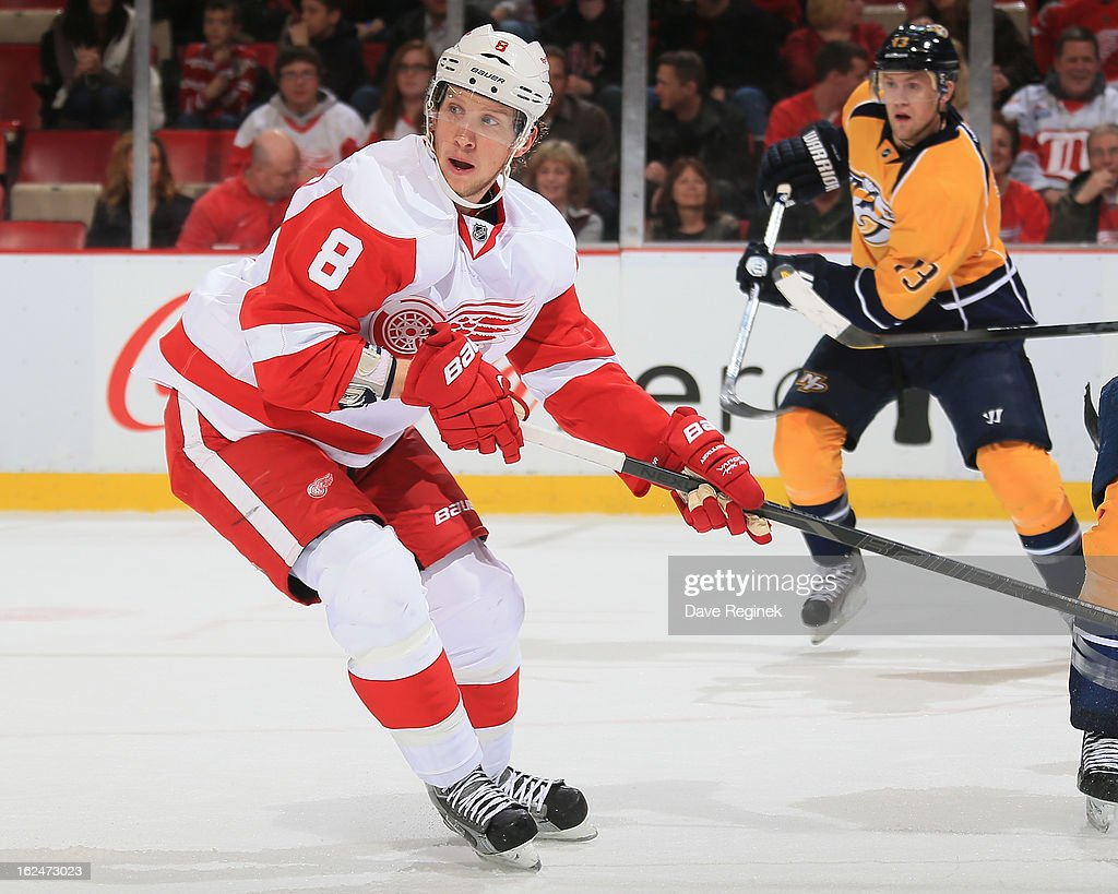 <a gi-track='captionPersonalityLinkClicked' href=/galleries/search?phrase=Justin+Abdelkader&family=editorial&specificpeople=2271858 ng-click='$event.stopPropagation()'>Justin Abdelkader</a> #8 of the Detroit Red Wings turns up ice during a NHL game against the Nashville Predators at Joe Louis Arena on February 23, 2013 in Detroit, Michigan. The Wings won 4-0