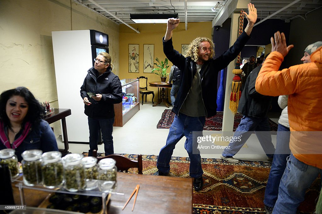 Justin Achenbach of Casper Wyoming runs around ecstatically at LoDo Wellness The first day of retail sales of marijuana in Colorado on Wednesday...
