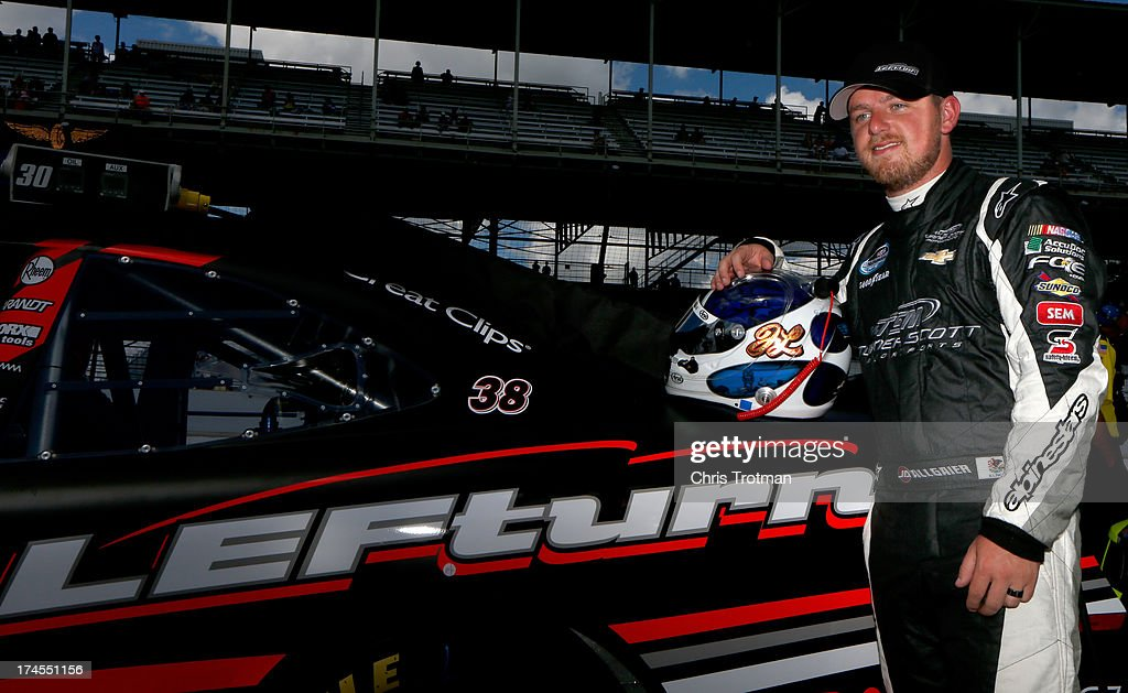 Justin Allgaier, driver of the #31 AccuDoc/Brandt/LEFturn Chevrolet, poses for a photo on the grid during qualifying for the NASCAR Nationwide Series Indiana 250 at Indianapolis Motor Speedway on July 27, 2013 in Indianapolis, Indiana.