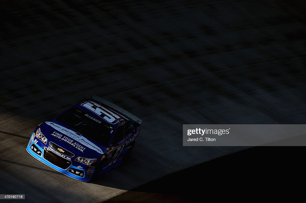 Justin Allgaier driver of the AutoOwners Insurance Chevrolet practices for the NASCAR Sprint Cup Series Food City 500 at Bristol Motor Speedway on...