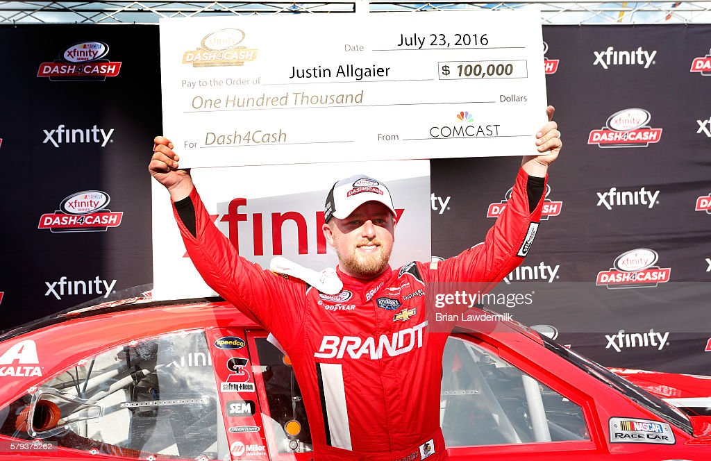 Justin Allgaier driver of the BRANDT Chevrolet celebrates after winning the Dash for Cash at the NASCAR XFINITY Series Lilly Diabetes 250 at...