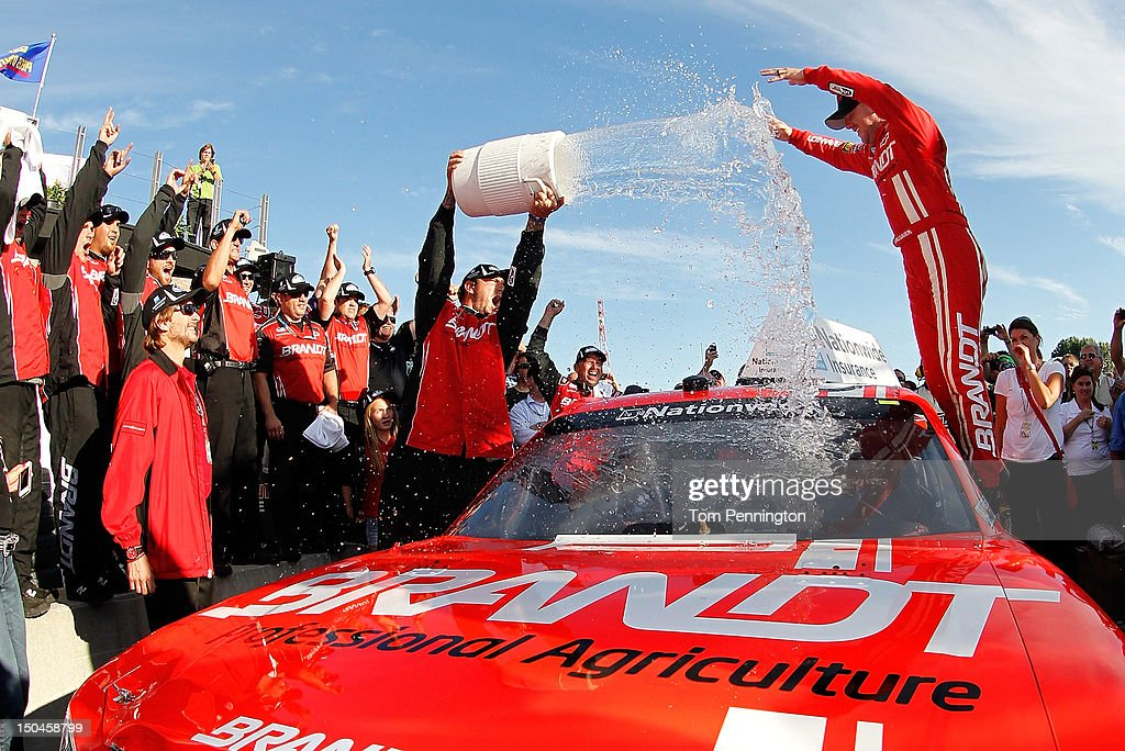 Justin Allgaier driver of the Brandt Chevrolet celebrates with his team after winning the NASCAR Nationwide Series sixth annual NAPA AUTO PARTS 200...