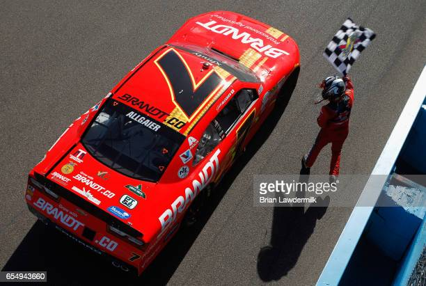 Justin Allgaier driver of the BRANDT Chevrolet celebrates with the checkered flag after winning the NASCAR XFINITY Series DC Solar 200 at Phoenix...