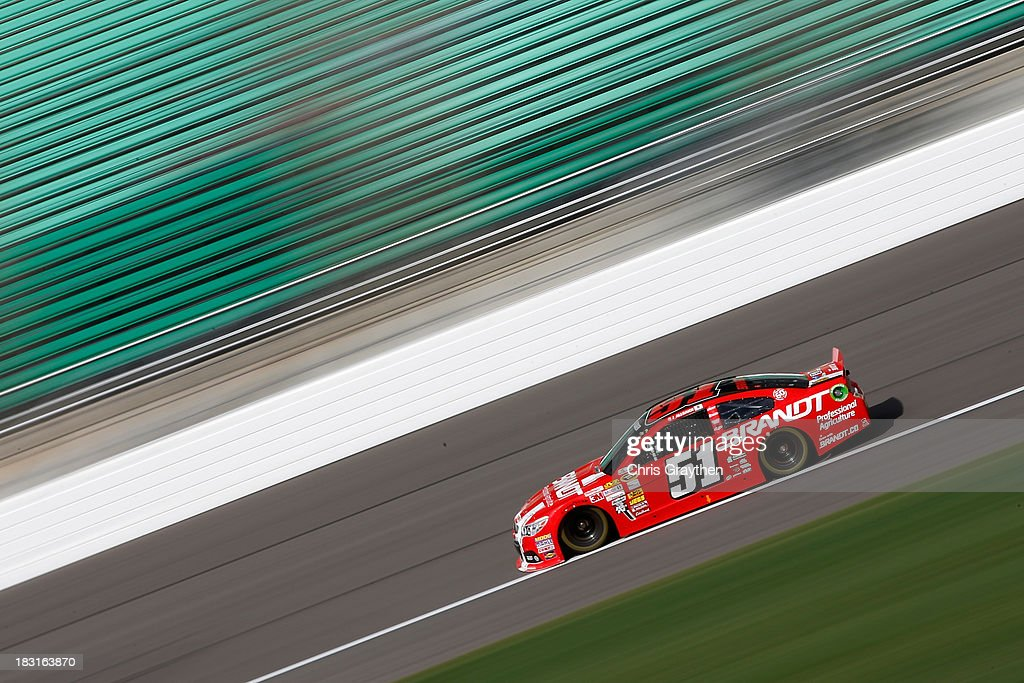 Justin Allgaier, driver of the #51 Brandt Chevrolet, practices for the NASCAR Sprint Cup Series 13th Annual Hollywood Casino 400 at Kansas Speedway on October 5, 2013 in Kansas City, Kansas.