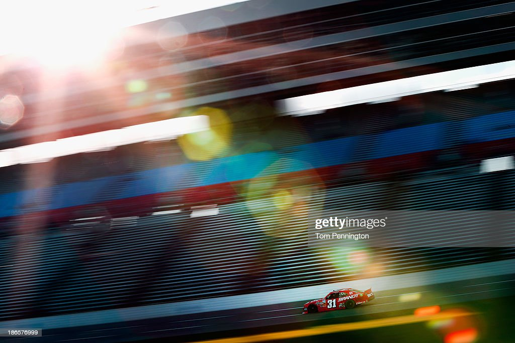 Justin Allgaier driver of the Brandt Chevrolet practices for the NASCAR Nationwide Series O'Reilly Auto Parts Challenge at Texas Motor Speedway on...