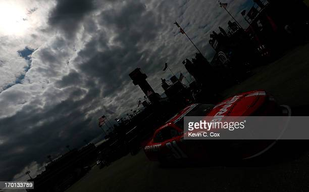 Justin Allgaier driver of the Brandt Chevrolet pulls out of the garage during practice for the NASCAR Nationwide Series DuPont Pioneer 250 at Iowa...