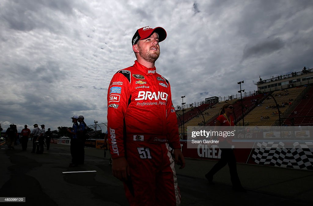 Justin Allgaier driver of the Brandt Chevrolet walks on the grid during qualifying for the NASCAR Sprint Cup Series CheezIt 355 at Watkins Glen...