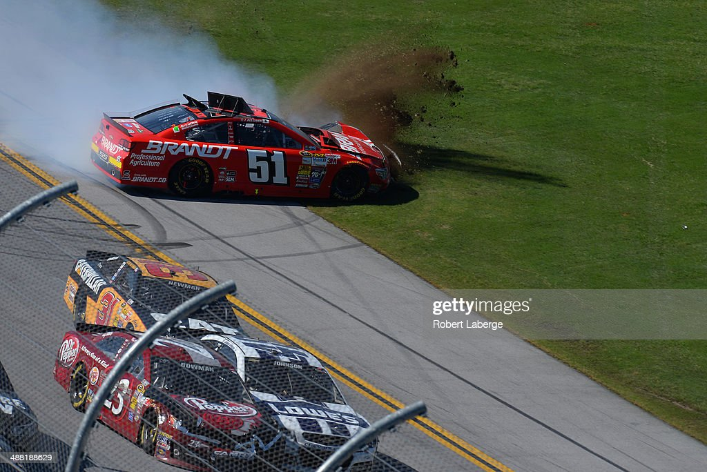 Justin Allgaier, driver of the #51 Brandt Professional Agriculture Chevrolet, is involved in an incident on the last lap of the NASCAR Sprint Cup Series Aaron's 499 at Talladega Superspeedway on May 4, 2014 in Talladega, Alabama.