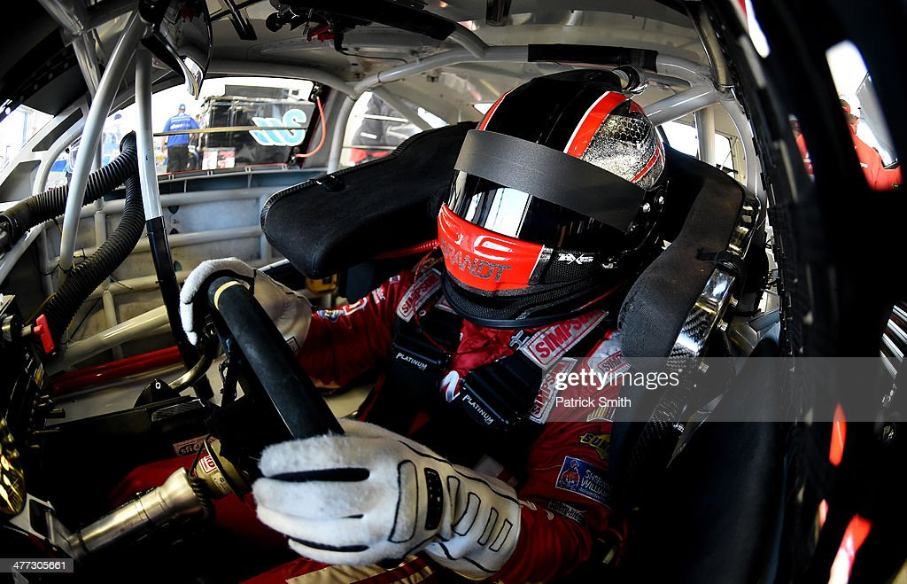 Justin Allgaier driver of the Brandt Professional Agriculture Chevrolet sits in his car during practice for the NASCAR Sprint Cup Series Kobalt 400...