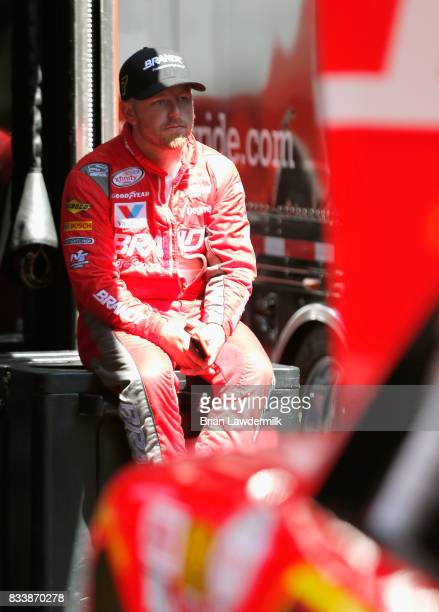 Justin Allgaier driver of the BRANDT Professional Agriculture Chevrolet stands by his car during practice for the NASCAR Xfinity Series Food City 300...