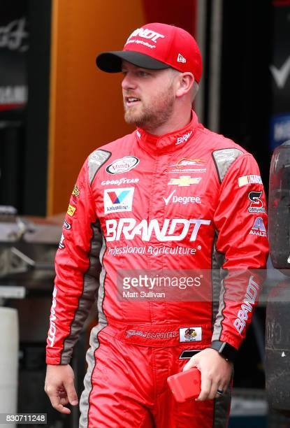 Justin Allgaier driver of the BRANDT Professional Agriculture Chevrolet walks to his car during practice for the NASCAR XFINITY Series MidOhio...