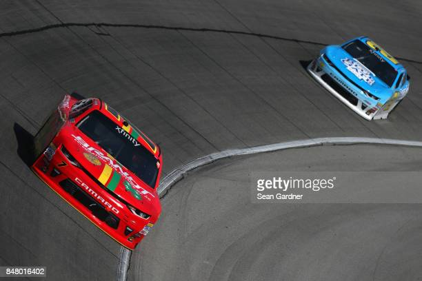 Justin Allgaier driver of the BRANDT/Celebrating the Future of AG Chevrolet leads Daniel Hemric driver of the Blue Gate Bank Chevrolet during the...