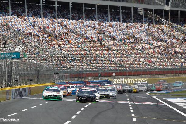 Justin Allgaier driver of the Breyers Chevrolet and Austin Dillon driver of the Rheem Chevrolet take the green flag to start the NASCAR Xfinity...