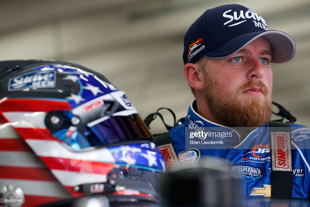 Justin Allgaier driver of the Suave Men Chevrolet stands in the garage area during practice for the NASCAR XFINITY Series Hisense 4K TV 300 at...
