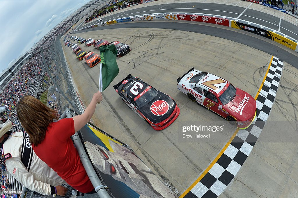Justin Allgaier driver of the TaxSlayercom Chevrolet and Ty Dillon driver of the Rheem Chevrolet lead the field to the green flag to start the NASCAR...