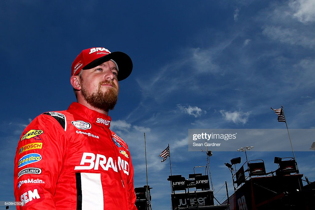 Justin Allgaier driver of the TradeMark Nitrogen Chevrolet walks through the garage area during practice for the NASCAR XFINITY Series Subway...