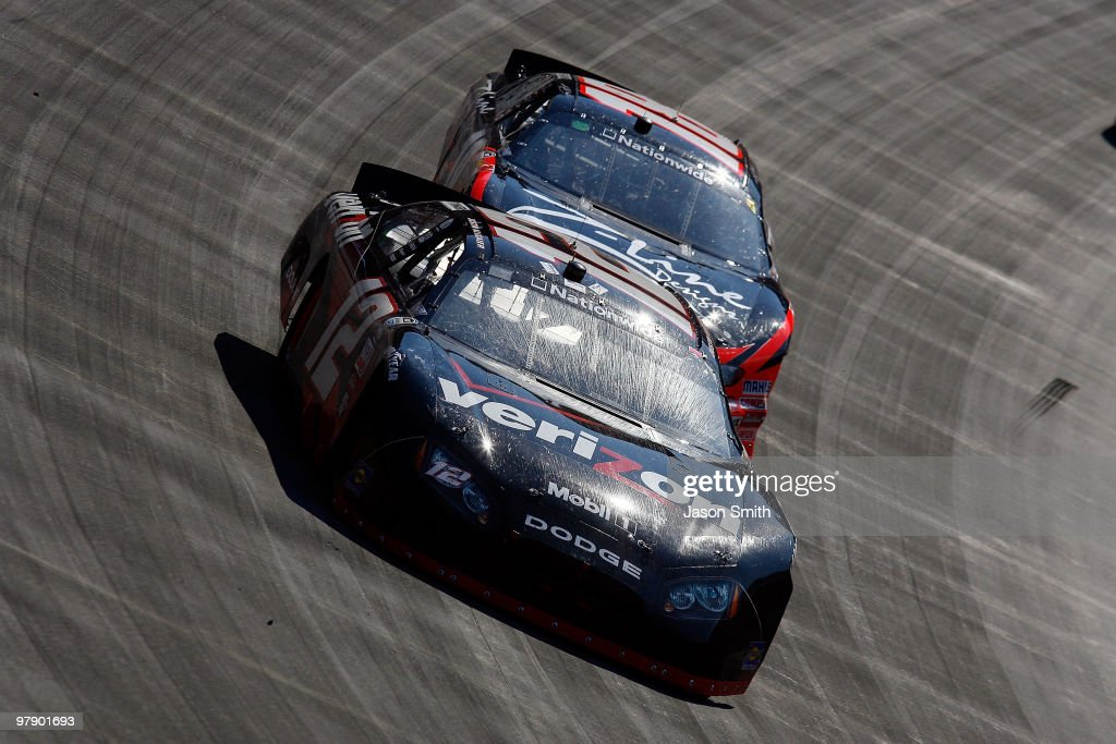 Justin Allgaier driver of the Verizon Dodge leads Kyle Busch driver of the ZLine Designs Toyota during the NASCAR Nationwide Series Scotts Turf...