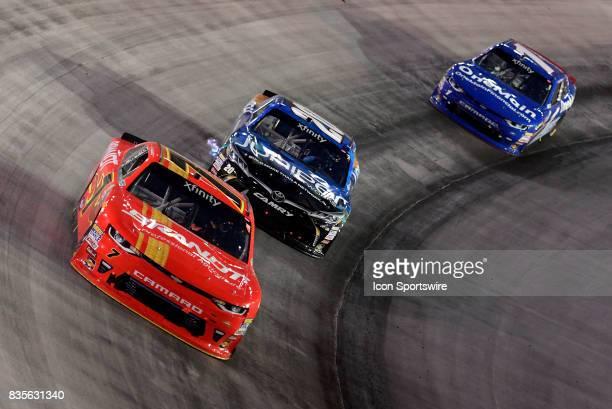 Justin Allgaier JR Motorsports Chevrolet Camaro and Daniel Suarez Joe Gibbs Racing Toyota Camry battle for position ahead of Elliott Sadler JR...