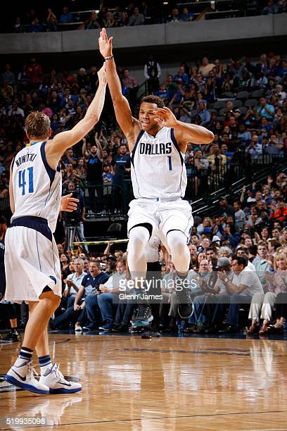 Justin Anderson and Dirk Nowitzki of the Dallas Mavericks high five against the Memphis Grizzlies on April 8 2016 at the American Airlines Center in...