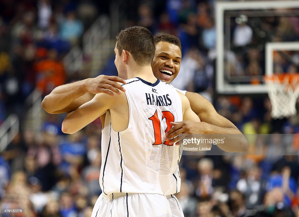 Justin Anderson #1 and Joe Harris #12 of the Virginia Cavaliers celebrate after beating the Duke Blue Devils in the finals of the 2014 Men's ACC Basketball Tournament at Greensboro Coliseum on March 16, 2014 in Greensboro, North Carolina.
