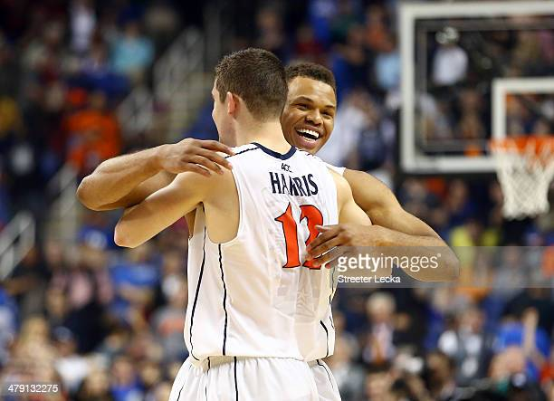 Justin Anderson and Joe Harris of the Virginia Cavaliers celebrate after beating the Duke Blue Devils in the finals of the 2014 Men's ACC Basketball...