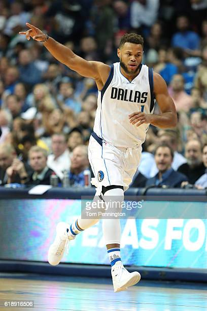 Justin Anderson of the Dallas Mavericks celebrates after scoring against the Houston Rockets in the first half at American Airlines Center on October...
