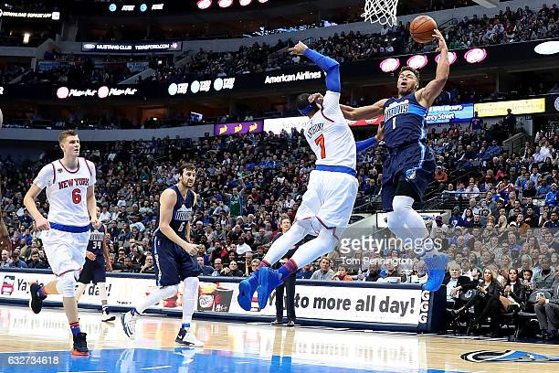 Justin Anderson of the Dallas Mavericks draws a foul against Carmelo Anthony of the New York Knicks in the second half at American Airlines Center on...