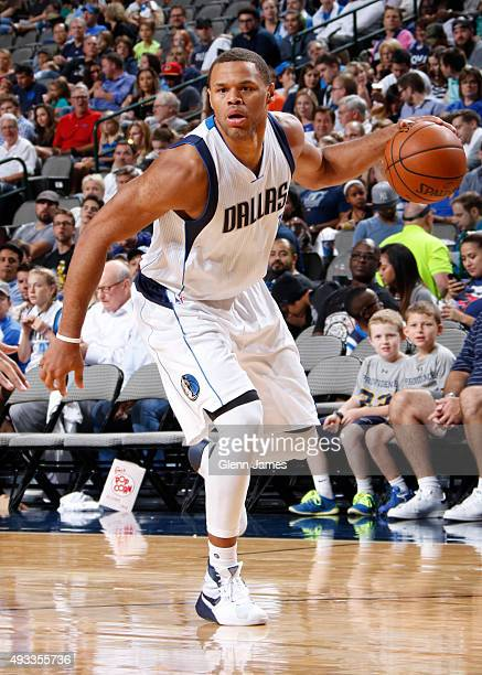 Justin Anderson of the Dallas Mavericks dribbles the ball against the Atlanta Hawks during a preseason game on October 16 2015 at the American...