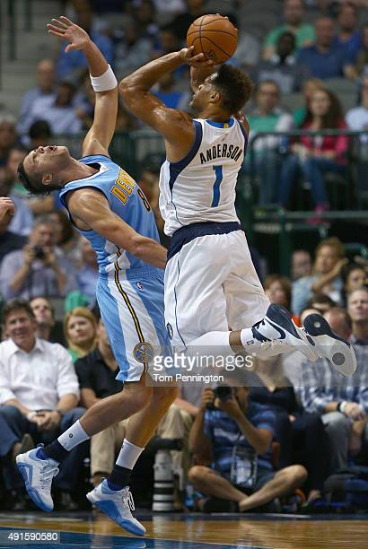 Justin Anderson of the Dallas Mavericks drives to the basket against Danilo Gallinari of the Denver Nuggets in the first half at American Airlines...