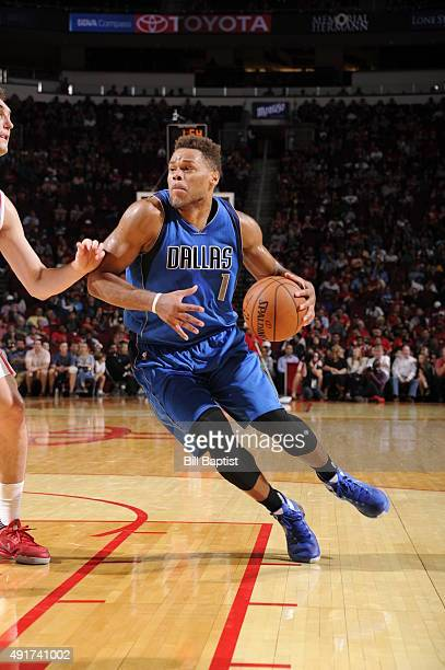 Justin Anderson of the Dallas Mavericks drives to the basket against the Houston Rockets during a preseason game on October 7 2015 at the Toyota...