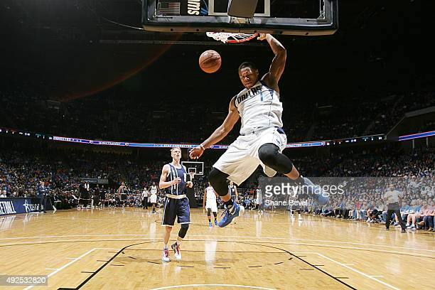 Justin Anderson of the Dallas Mavericks dunks against the Oklahoma City Thunder during a preseason game on October 13 2015 at the BOK Center in Tulsa...