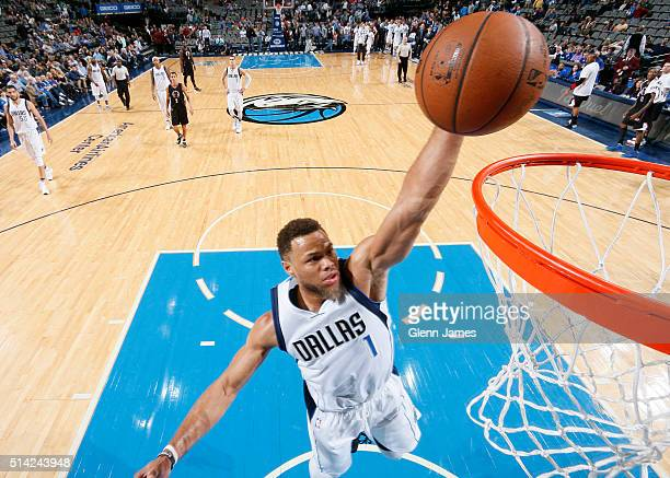 Justin Anderson of the Dallas Mavericks flies in for the dunk against the Los Angeles Clippers on March 7 2016 at the American Airlines Center in...