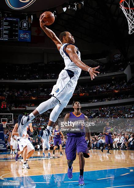 Justin Anderson of the Dallas Mavericks flies in for the slam against the Phoenix Suns on October 21 2015 at the American Airlines Center in Dallas...