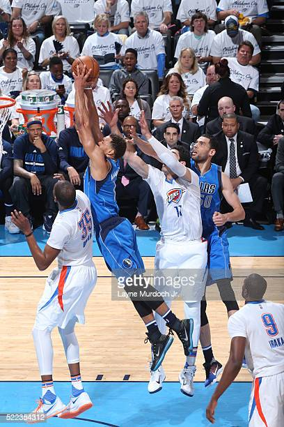 Justin Anderson of the Dallas Mavericks grabs the rebound against the Oklahoma City Thunder in Game Two of Western Conference Quarterfinals of the...