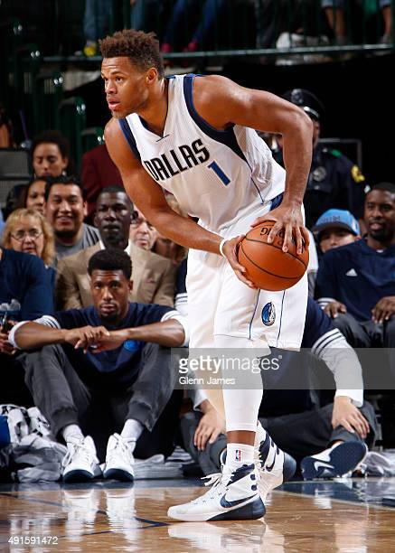 Justin Anderson of the Dallas Mavericks handles the ball against the Denver Nuggets on October 6 2015 at the American Airlines Center in Dallas Texas...