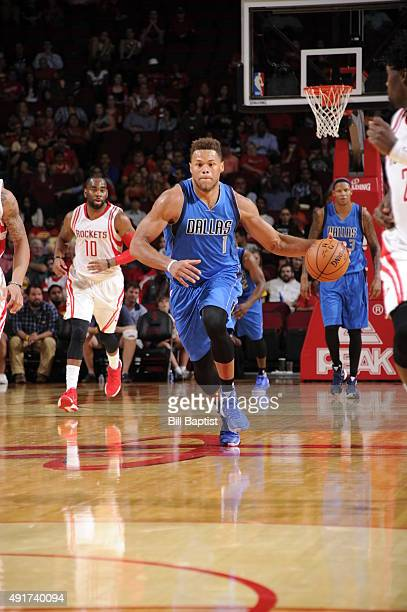 Justin Anderson of the Dallas Mavericks handles the ball against the Houston Rockets during a preseason game on October 7 2015 at the Toyota Center...