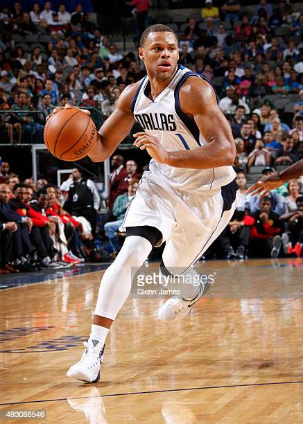 Justin Anderson of the Dallas Mavericks handles the ball against the Atlanta Hawks on October 16 2015 at the American Airlines Center in Dallas Texas...