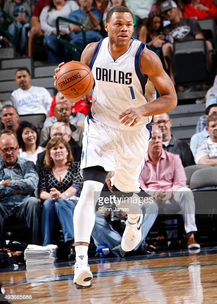 Justin Anderson of the Dallas Mavericks handles the ball against the Phoenix Suns on October 21 2015 at the American Airlines Center in Dallas Texas...