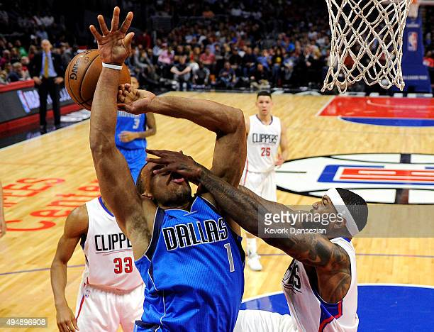 Justin Anderson of the Dallas Mavericks is fouled by Josh Smith of the Los Angeles Clippers during the fourth quarter of the basketball game at...