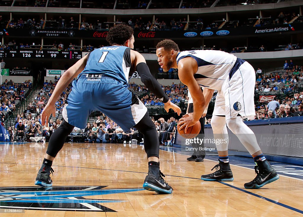 Justin Anderson #1 of the Dallas Mavericks looks to drive against Tyus Jones #1 of the Minnesota Timberwolves on February 28, 2016 at the American Airlines Center in Dallas, Texas.