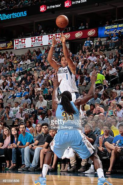 Justin Anderson of the Dallas Mavericks shoots a jumper against the Denver Nuggets on October 6 2015 at the American Airlines Center in Dallas Texas...