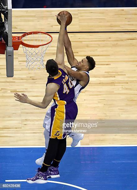 Justin Anderson of the Dallas Mavericks takes a shot against Ivica Zubac of the Los Angeles Lakers at American Airlines Center on January 22 2017 in...
