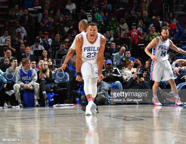 Justin Anderson of the Philadelphia 76ers is pumped up after dunking the ball against the Dallas Mavericks at Wells Fargo Center on March 17 2017 in...