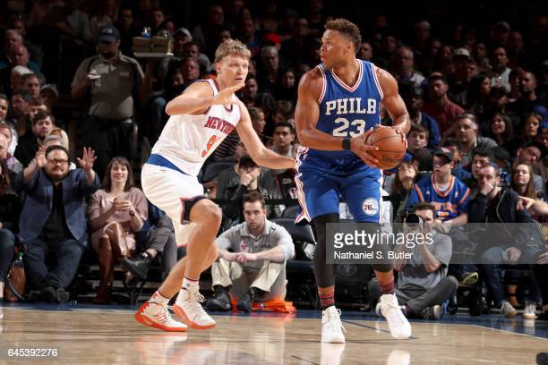 Justin Anderson of the Philadelphia 76ers looks to pass the ball against the New York Knicks on February 25 2017 at Madison Square Garden in New York...