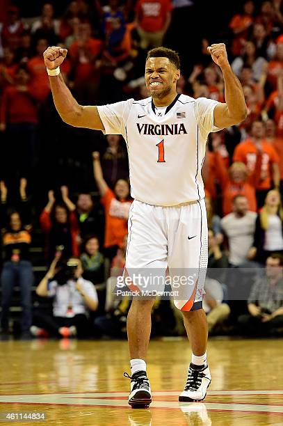 Justin Anderson of the Virginia Cavaliers celebrates after a basket in the second half during a game against the North Carolina State Wolfpack at...